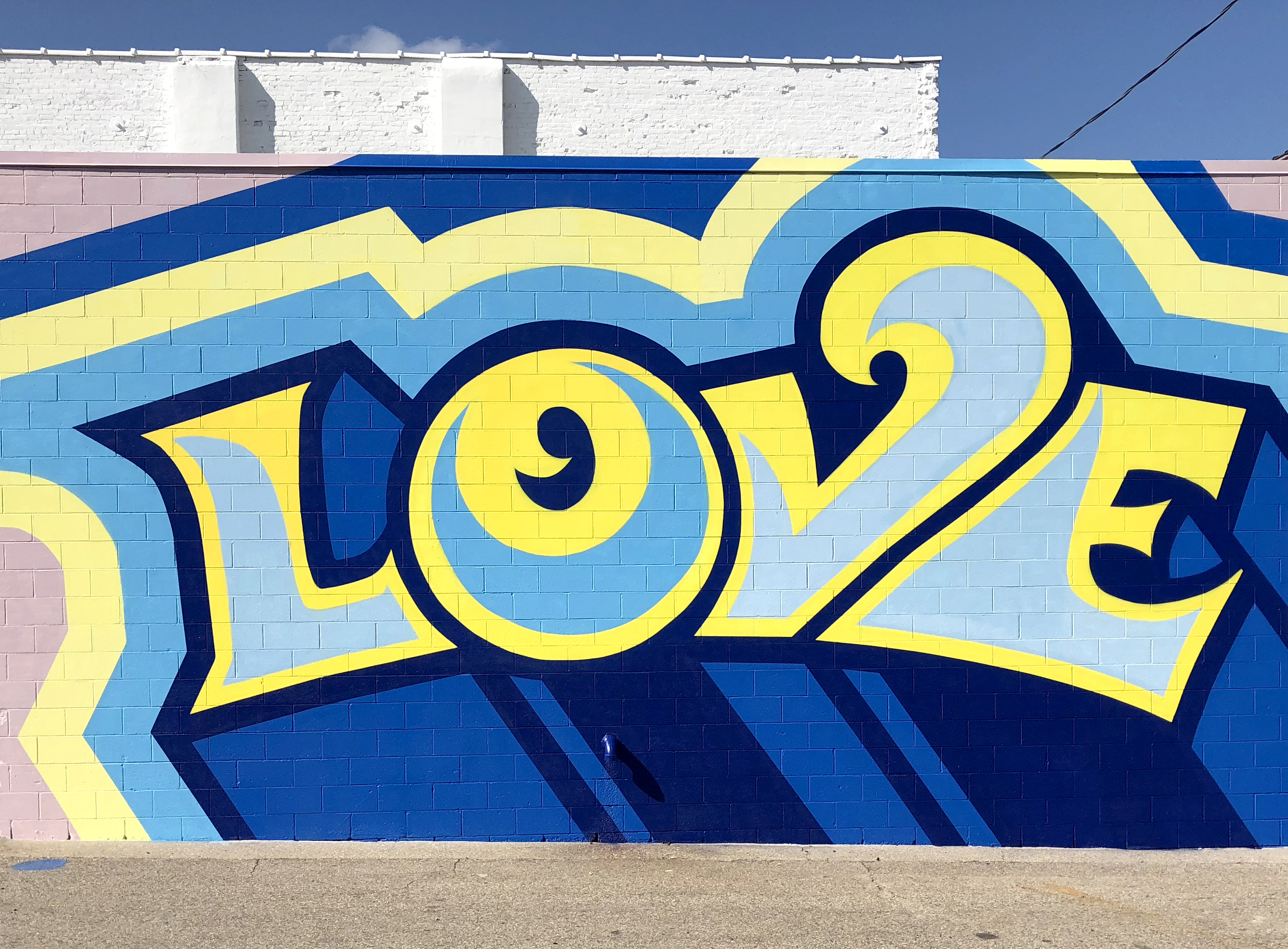 Love, Jackson, Mi 2018, Spray paint and Latex on wall, 384X192 inches