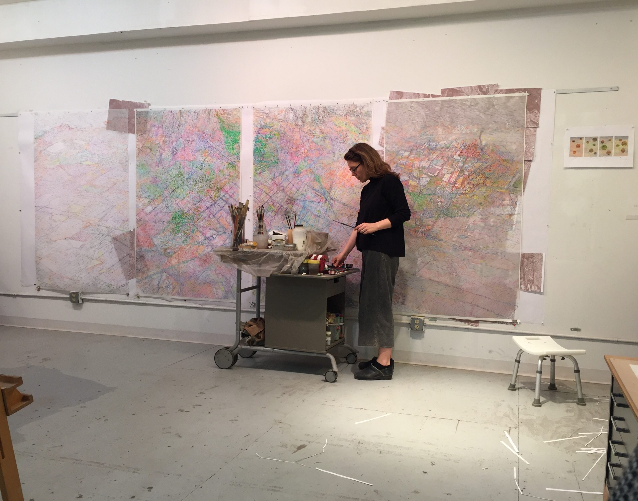 Simonetta Moro at work on the panels representing a view of Mexico City