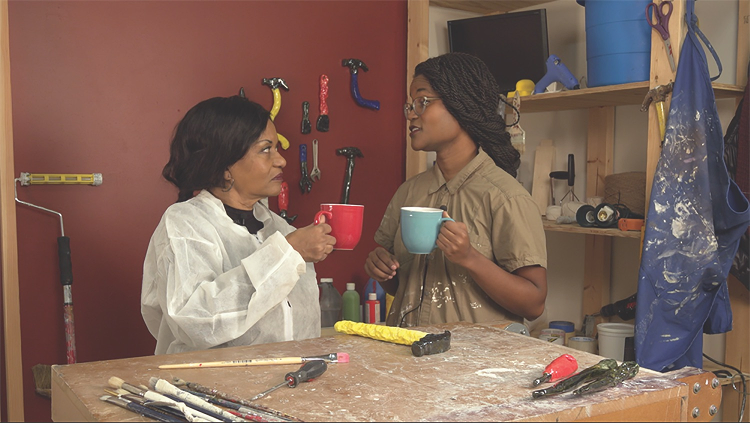 Image still of two women holding cups