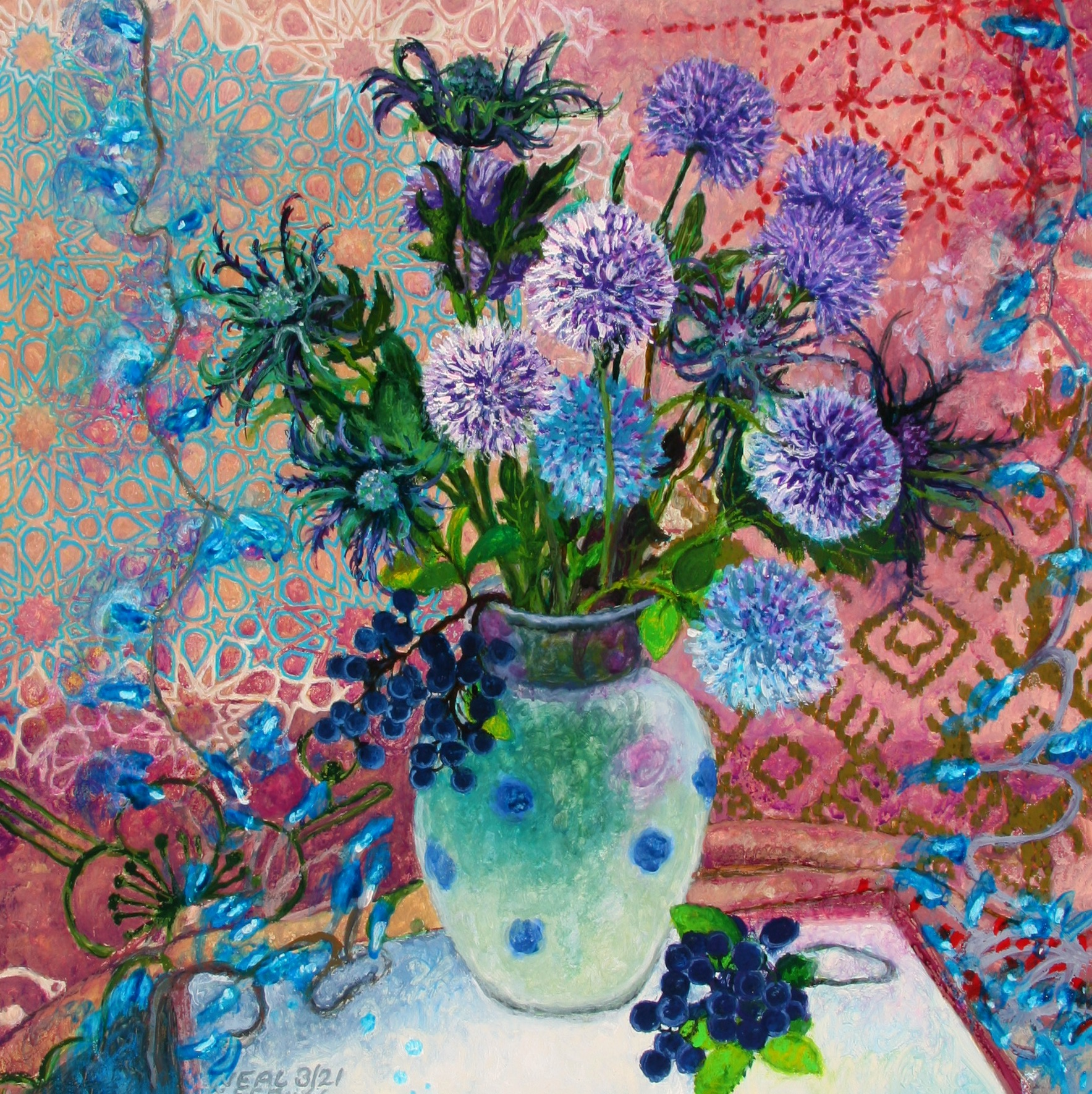 Blue and purple flowers in a vase with a patterned ground